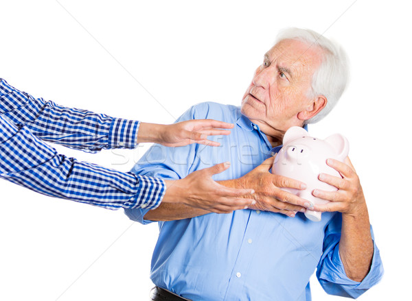 4056303_stock-photo-grandpa-protecting-his-savings.jpg