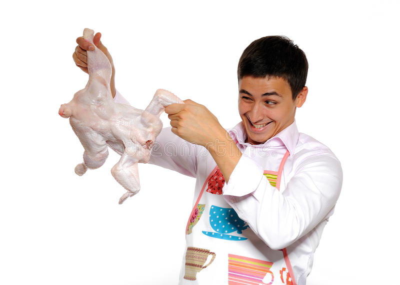 de-knappe-het-koken-kip-van-de-jonge-mensenholding-16215064.jpg