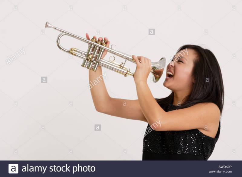 stock-photograph-of-a-pretty-asian-girl-screaming-into-a-trumpet-AWDK0P.jpg
