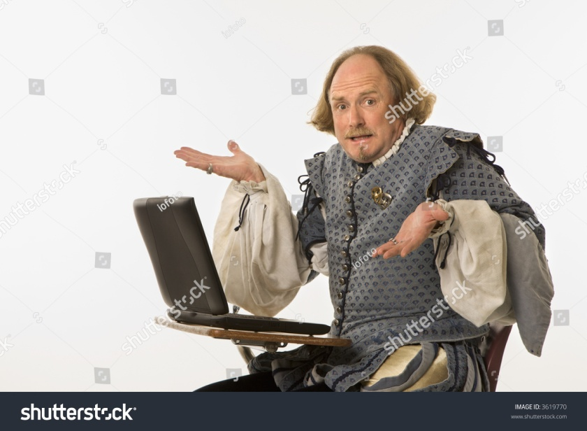 stock-photo-william-shakespeare-in-period-clothing-sitting-in-school-desk-with-laptop-computer-shrugging-at-3619770.jpg